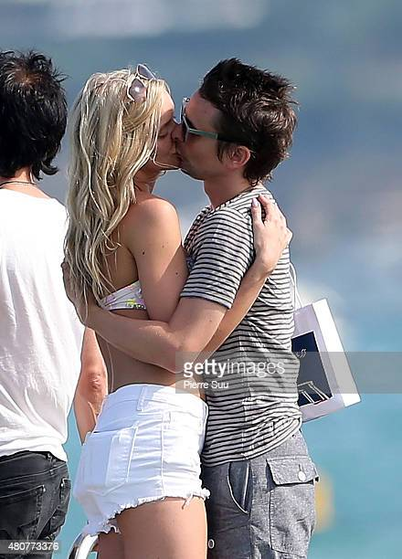 Matt Bellamy and Elle Evans share a kiss at club 55 on July 15 2015 in SaintTropez France