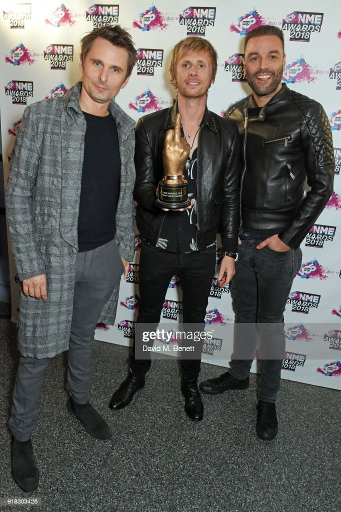 Matt Bellamy, Dominic Howard and Chris Wolstenholme of Muse in the winners room during the VO5 NME Awards held at Brixton Academy on February 14, 2018 in London, England.