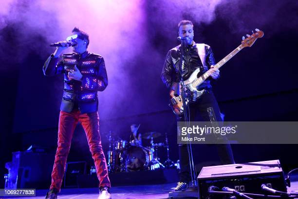 Matt Bellamy, Dominic Howard, and Chris Wolstenholme of Muse perform onstage at Not So Silent Night presented by Radio.com at Barclays Center on...