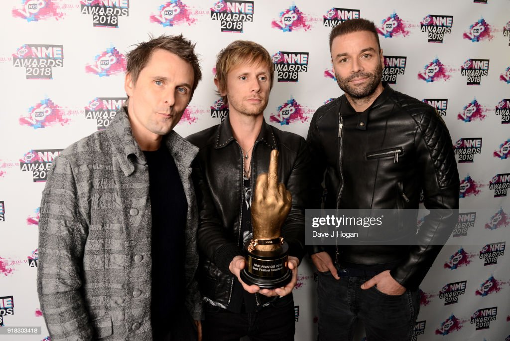 Matt Bellamy, Dominic Howard and Chris Wolstenholme of Muse pose in the winners room with the award for Best Festival Headliner at the VO5 NME Awards held at Brixton Academy on February 14, 2018 in London, England.