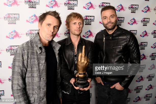 Matt Bellamy Dominic Howard and Chris Wolstenholme of Muse pose in the winners room with the award for Best Festival Headliner at the VO5 NME Awards...