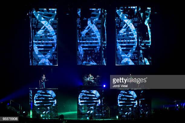 Matt Bellamy, Dominic Howard and Christopher Wolstenholme perform on stage at Palau Sant Jordi on November 24, 2009 in Barcelona, Spain.