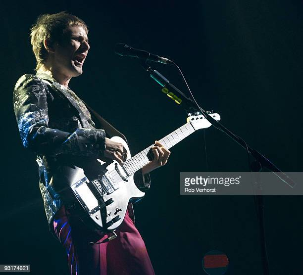 Matt Bellamy of Muse performs on stage at Ahoy on November 14 2009 in Rotterdam Netherlands