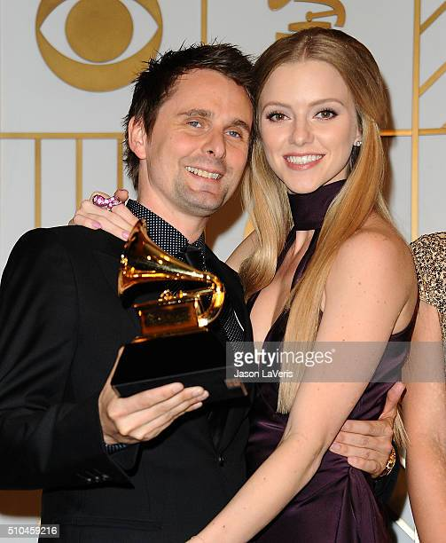 Matt Bellamy of thre band Muse and model Elle Evans pose in the press room at the The 58th GRAMMY Awards at Staples Center on February 15, 2016 in...