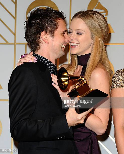 Matt Bellamy of thre band Muse and model Elle Evans pose in the press room at the The 58th GRAMMY Awards at Staples Center on February 15 2016 in Los...