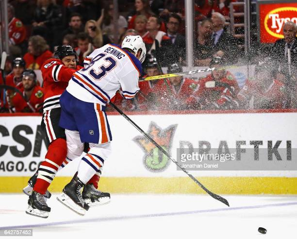 Matt Benning of the Edmonton Oilers collides with Tanner Kero of the Chicago Blackhawks at the United Center on February 18 2017 in Chicago Illinois