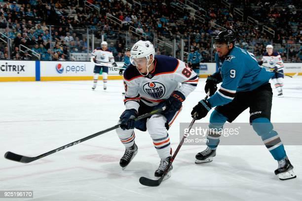 Matt Benning of the Edmonton Oilers skates against Evander Kane of the San Jose Sharks at SAP Center on February 27 2018 in San Jose California
