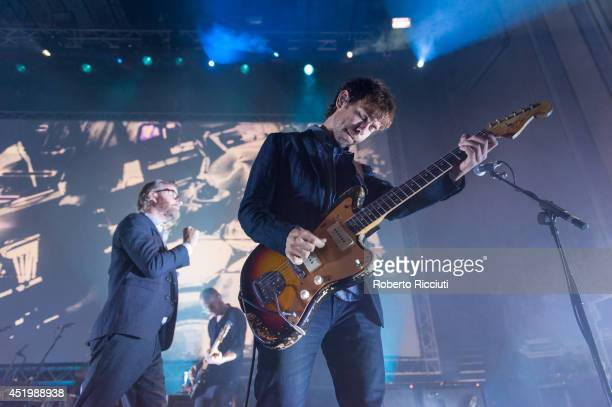 Matt Berninger, Scott Devendorf and Aaron Dessner of The National perform on stage at Usher Hall on July 10, 2014 in Edinburgh, United Kingdom.