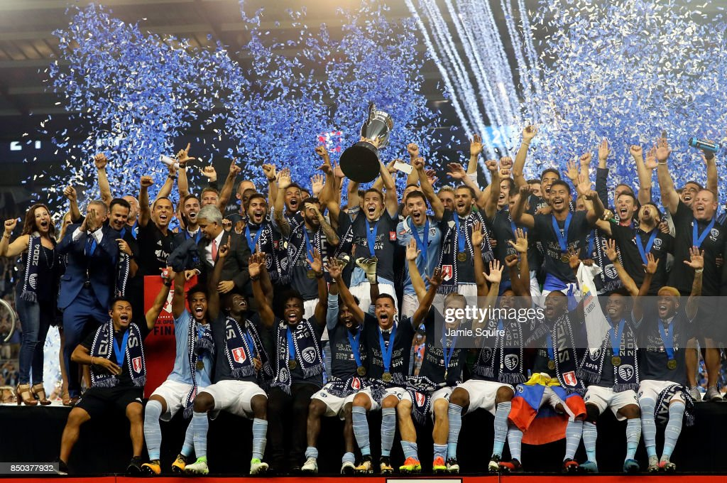 Matt Besler #5 and Sporting Kansas City celebrate with the trophy after they defeated New York Red Bulls 2-1 to win the 2017 U.S Open Cup Final at Children's Mercy Park on September 20, 2017 in Kansas City, Kansas.