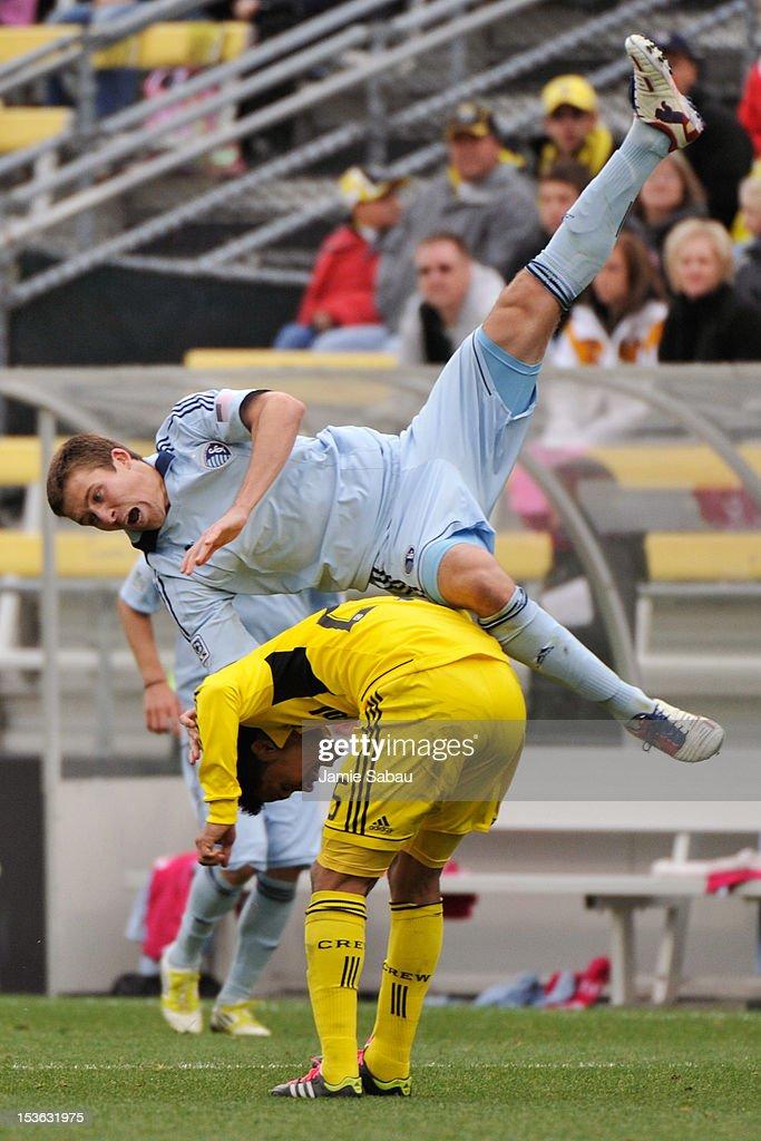 Matt Besler #5 of Sporting Kansas City flips over Jairo Arrieta #25 of the Columbus Crew while going for a header on a loose ball on October 7, 2012 at Crew Stadium in Columbus, Ohio.