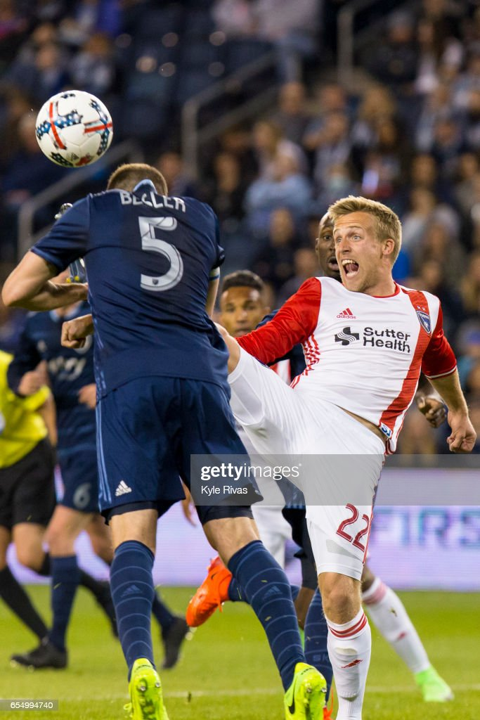Matt Besler #5 of Sporting Kansas City is hit in the face by the shoe of Tommy Thompson #22 of San Jose Earthquakes inside the Sporting Kansas City penalty box late in the second half at Children's Mercy Park on March 18, 2017 in Kansas City, Kansas.