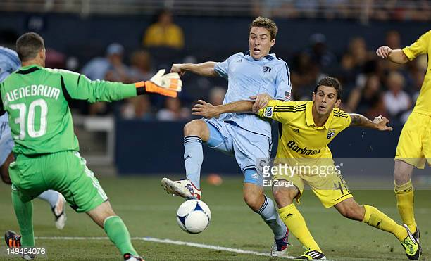 Matt Besler of the Sporting Kansas City takes a shot on goal against Andy Gruenebaum of the Columbus Crew and Carlos Mendes in the second half at...