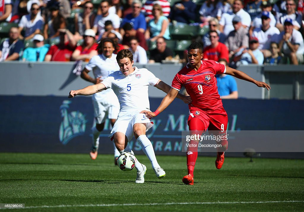 Matt Besler #5 of the USA plays the ball from Rolando Blackburn #9 of Panama in the first half during the international men's friendly match at StubHub Center on February 8, 2015 in Los Angeles, California. The USA defeated Panama 2-0.