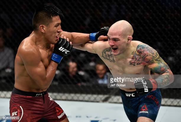 Matt Bessette and Enrique Barzola of Peru trade punches in their featherweight bout during the UFC 220 event at TD Garden on January 20 2018 in...