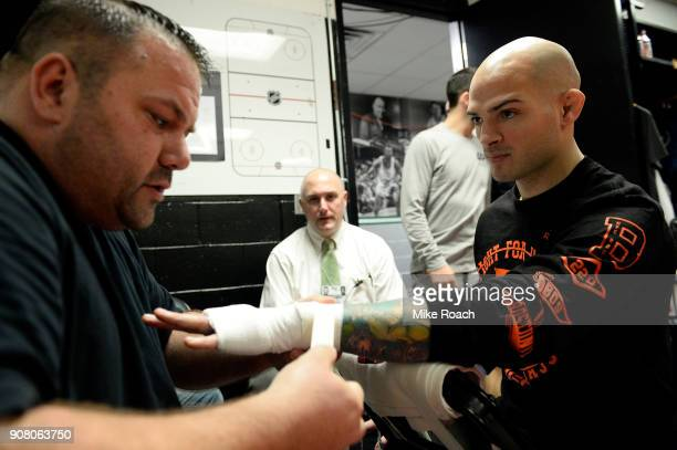 Matt Bessette has his hands wrapped prior to his bout against Enrique Barzola during the UFC 220 event at TD Garden on January 20 2018 in Boston...
