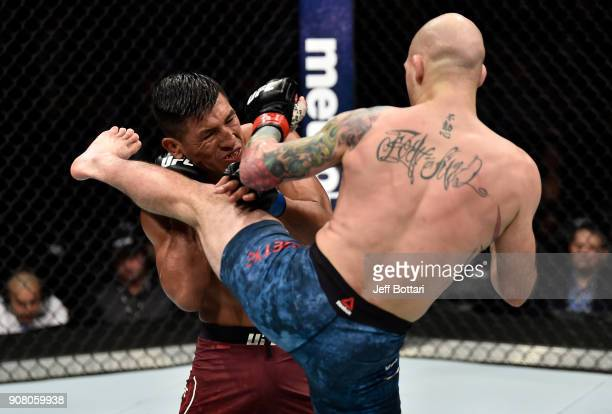 Matt Bessette kicks Enrique Barzola of Peru in their featherweight bout during the UFC 220 event at TD Garden on January 20 2018 in Boston...