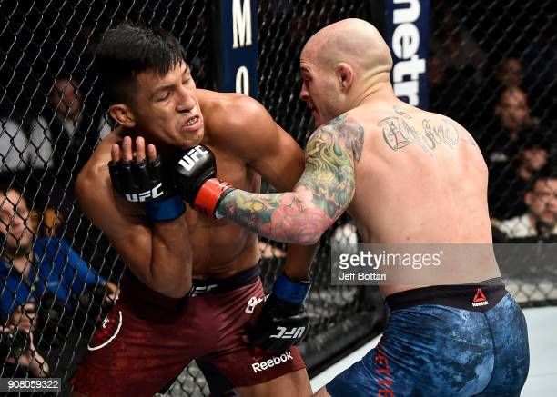 Matt Bessette punches Enrique Barzola of Peru in their featherweight bout during the UFC 220 event at TD Garden on January 20 2018 in Boston...