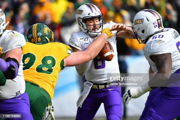 Matt Biegler of the North Dakota State Bison gets pressure on Ben DiNucci of the James Madison Dukes during the Division I FCS Football Championship...