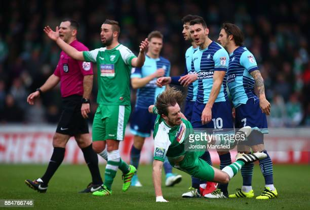 Matt Bloomfield of Wycombe Wanderers and Jack Midson of Letherhead clash during The Emirates FA Cup Second Round between Wycombe Wanderers and...