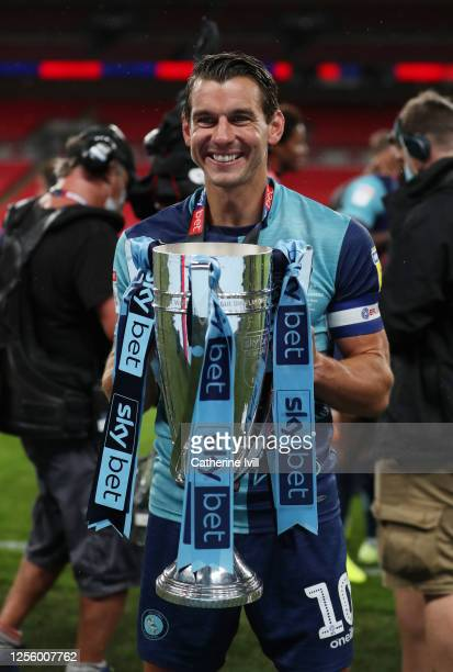 Matt Bloomfield of Wycombe Wanderers celebrates with the trophy after the Sky Bet League One Play Off Final between Oxford United and Wycombe...
