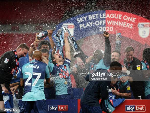 Matt Bloomfield of Wycombe Wanderers celebrates with the trophy during the Sky Bet League One Play Off Final between Oxford United and Wycombe...