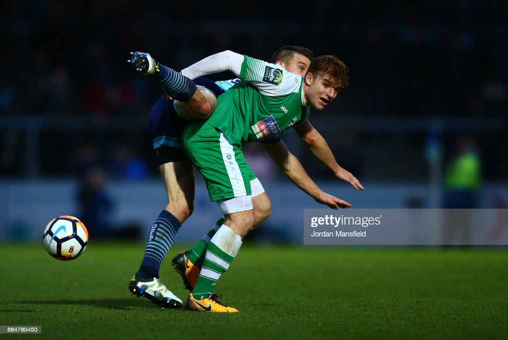 Matt Bloomfield of Wycombe Wanderers challenges Sam Blackman of Letherhead during The Emirates FA Cup Second Round between Wycombe Wanderers and Leatherhead at Adams Park on December 3, 2017 in High Wycombe, England.