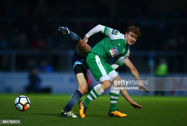 Matt Bloomfield of Wycombe Wanderers challenges Sam Blackman of Letherhead during The Emirates FA Cup Second Round between Wycombe Wanderers and...
