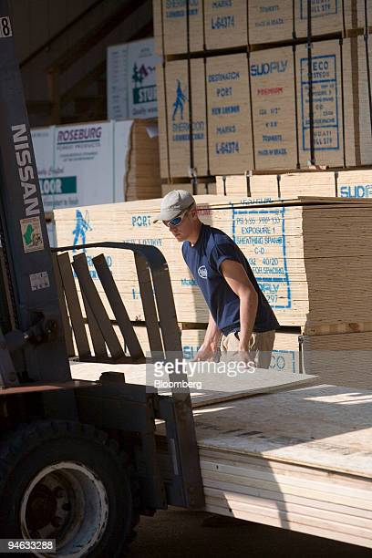 Matt Boczenowski a worker at National Lumber loads a forklift the company's yard in Newton Massachusetts Tuesday October 10 2006 Inventories at US...