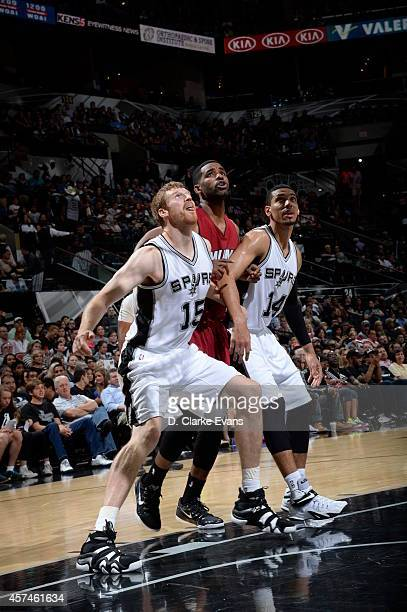 Matt Bonner and Danny Green of the San Antonio Spurs battle for position against the Miami Heat at the ATT Center on October 18 2014 in San Antonio...