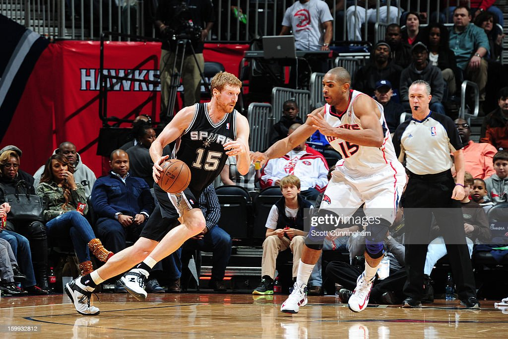 Matt Bonner #15 of the San Antonio Spurs drives to the basket against Al Horford #15 of the Atlanta Hawks on January 19, 2013 at Philips Arena in Atlanta, Georgia.