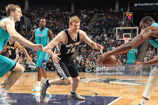 Matt Bonner of the San Antonio Spurs goes for the loose ball against the Charlotte Hornets during the game at the Time Warner Cable Arena on January...