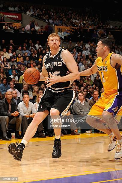 Matt Bonner of the San Antonio Spurs handles the ball against Jordan Farmar of the Los Angeles Lakers during the game on February 8 2010 at Staples...