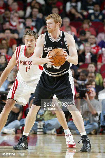 Matt Bonner of the San Antonio Spurs moves the ball against David Andersen of the Houston Rockets during the game on November 27 2009 at the Toyota...