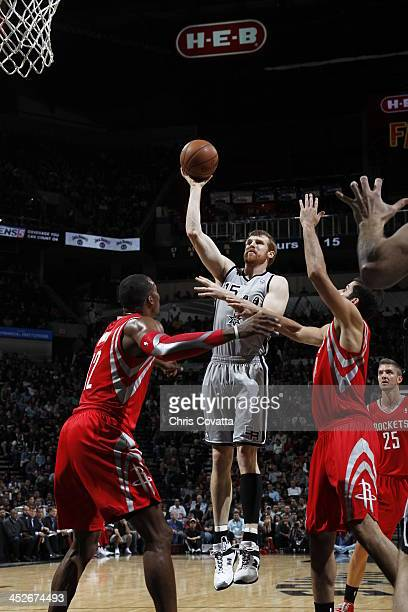 Matt Bonner of the San Antonio Spurs shoots against Dwight Howard of the Houston Rockets on November 30 2013 at the ATT Center in San Antonio Texas...