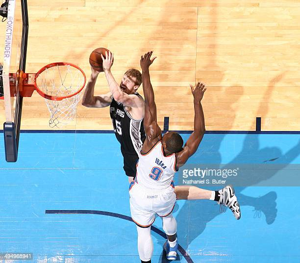 Matt Bonner of the San Antonio Spurs shoots against Serge Ibaka of the Oklahoma City Thunder in Game 6 of the Western Conference Finals during the...