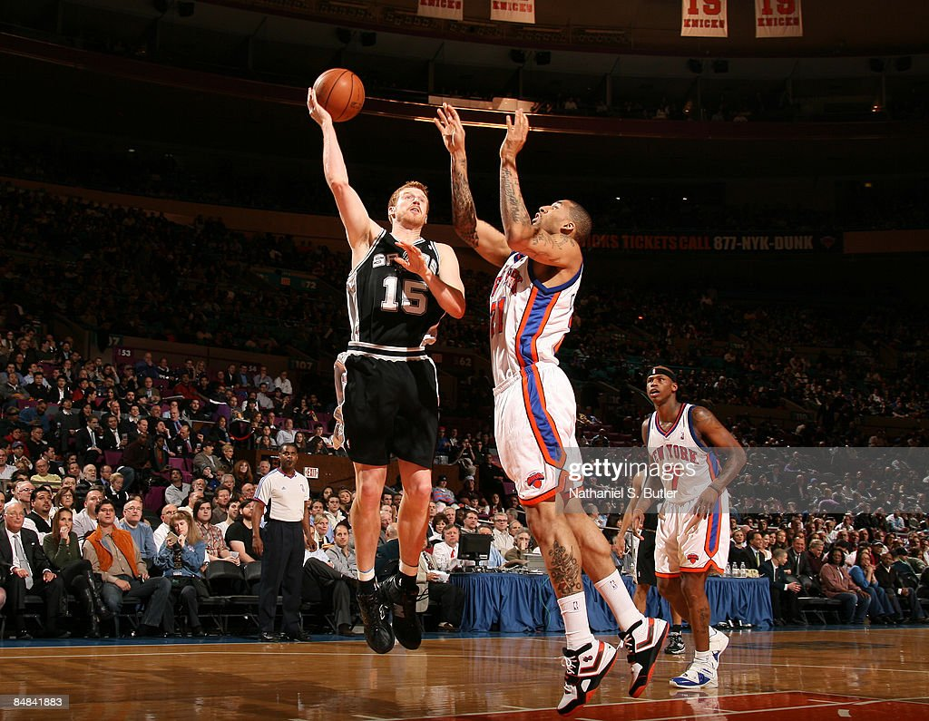 Matt Bonner #15 of the San Antonio Spurs shoots against Wilson Chandler #21 of the New York Knicks on February 17, 2009 at Madison Square Garden in New York City.