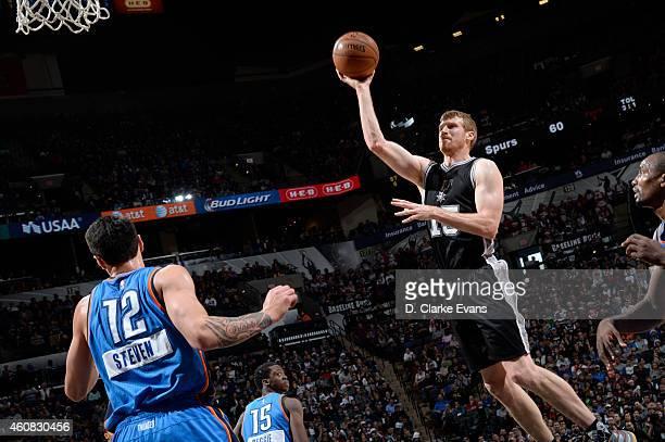 Matt Bonner of the San Antonio Spurs shoots during a game against the Oklahoma City Thunder at the ATT Center on December 25 2014 in San Antonio...
