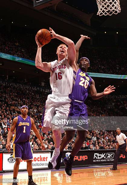 Matt Bonner of the Toronto Raptors takes it hard to the basket against Jumaine Jones of the Los Angeles Lakers on February 27, 2005 at the Air Canada...