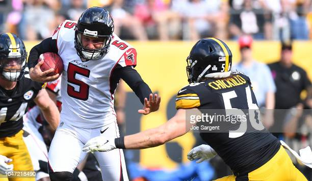 Matt Bosher of the Atlanta Falcons attempts to run with the block after a blocked punt in the second half during the game against the Pittsburgh...