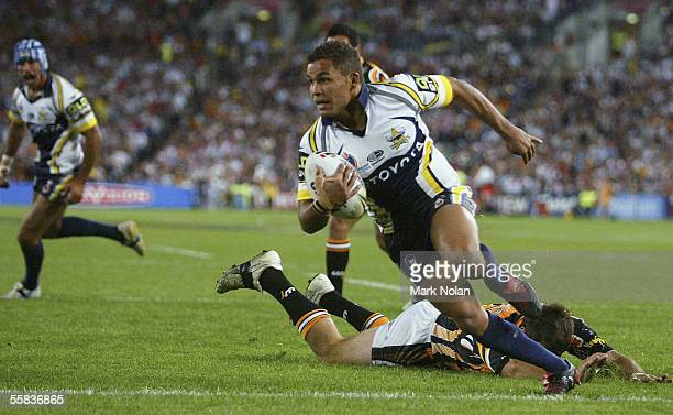 Matt Bowen of the Cowboys heads for a try during the 2005 NRL Grand Final between Wests Tigers and the North Queensland Cowboys at Telstra Stadium on...