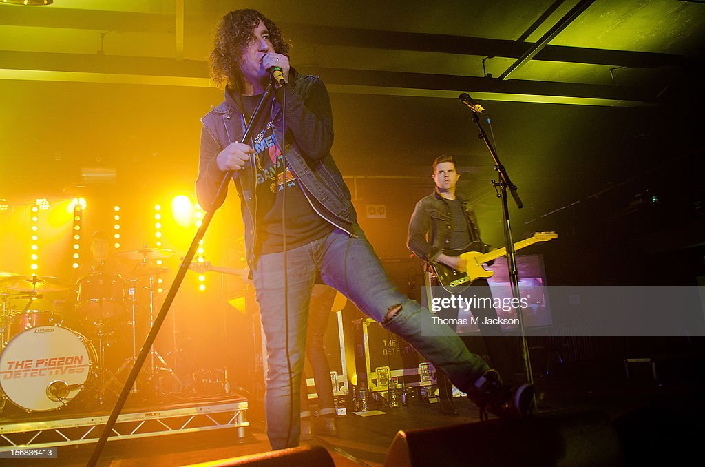 Matt Bowman and Ryan Wilson of Pigeon Detectives perform onstage at Newcastle University on November 22, 2012 in Newcastle upon Tyne, England.