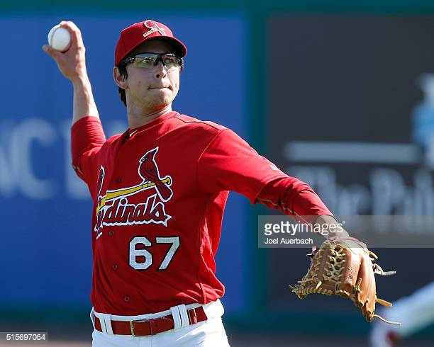 Matt Bowman of the St Louis Cardinals throws the ball prior to a spring training game against the Minnesota Twins at Roger Dean Stadium on March 14...
