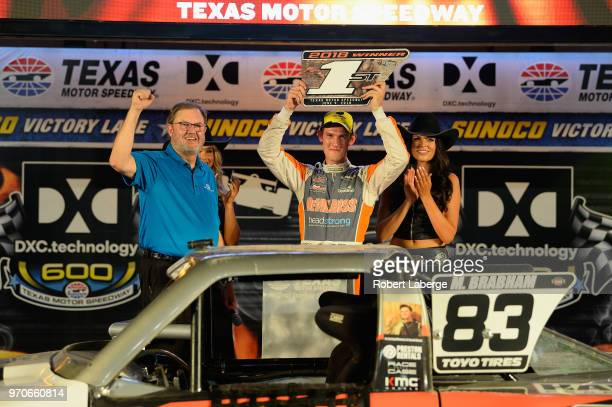 Matt Brabham, driver of the Devilbiss truck poses for a photo in Victory Lane after winning the Speed Energy Stadium Super Trucks Series race at...