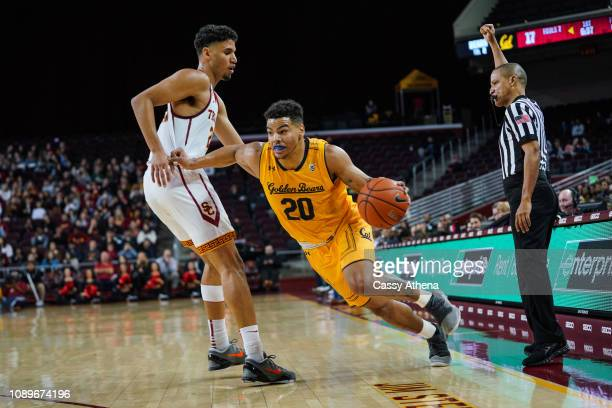 Matt Bradley of the Cal Bears drives the ball against Bennie Boatwright of the USC Trojans at The Galen Center on January 3 2019 in Los Angeles...