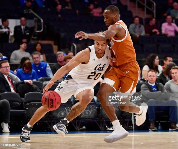 Matt Bradley of the California Golden Bears drives past Matt Coleman III of the Texas Longhorns during the second half of their game at Madison...