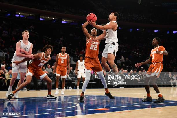 Matt Bradley of the California Golden Bears drives to the basket past Kai Jones of the Texas Longhorns during the second half of their game at...
