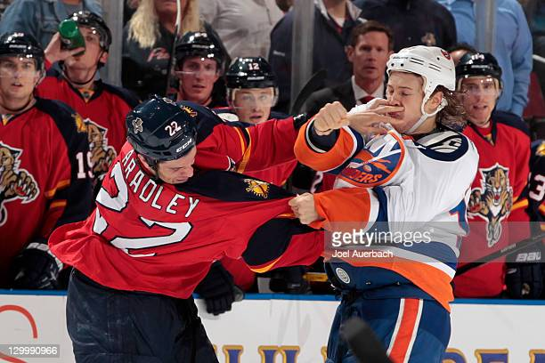 Matt Bradley of the Florida Panthers and Matt Martin of the New York Islanders fight during the first period on October 22 2011 at the BankAtlantic...