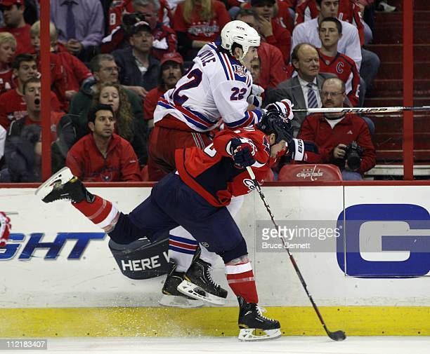 Matt Bradley of the Washington Capitals hits Brian Boyle of the New York Rangers in Game One of the Eastern Conference Quarterfinals during the 2011...