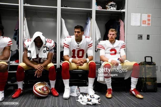 Matt Breida Jimmy Garoppolo and CJ Beathard of the San Francisco 49ers relax in the locker room prior to the game against the Minnesota Vikings at US...