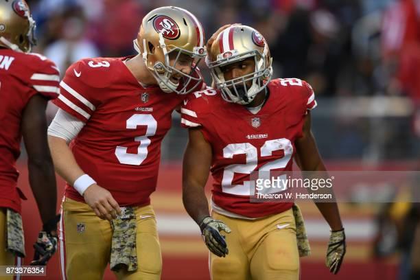 Matt Breida of the San Francisco 49ers celebrates with CJ Beathard after a 22yard touchdown against the New York Giants during their NFL game at...